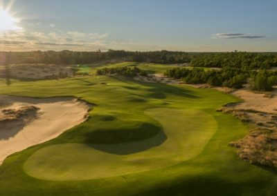Sand Valley Resort Mammoth Dunes Golf Course Hole 6 Green Aerial Sunrise STOCK
